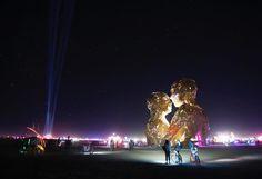 Some #burners check out the Embrace #art piece. :') #blackrockcity #burningman