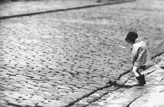 John Bulmer A little boy urinates in the street in Nelson, Lancashire, 1960′s