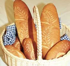 Bread Stencil Pattern Techniques  Adding a design to your breads can set your product apart from the competition. By just adding a simple fleur de lis, wheat sheath or logo, you can personalize your artisan breads for a quality look.  In this photo, we used flour and our wheat stencil (C217) to add style to our loaves.  Watch our video on how to decorate your breads with stencils!