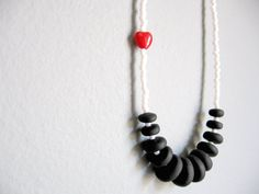 black discs, white beads and a red heart necklace by pergamondo on etsy