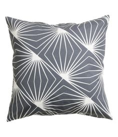 Cushion cover in cotton twill with a printed pattern. Concealed zip.