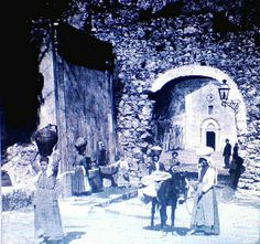 Taormina (Vintage photo) - La porta dei Cappuccini nel 1800 (La fontanella c'è sempre). Taormina is a comune and small town on the east coast of the island of Sicily, Italy, in the Province of Messina, about midway between Messina and Catania. Taormina has been a very popular tourist destination since the 19th century. It has popular beaches (accessible via an aerial tramway) on the Ionian sea, which is remarkably warm and has a high salt content... Courtesy: Luigi Strano, Taormina (Italia)