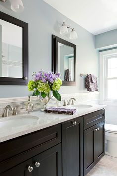 The 12 Best Bathroom Paint Colors Our Editors Swear By - blue-gray bathroom walls with black vanity and mirrors - Best Bathroom Paint Colors, Gray Bathroom Walls, Bathroom Color Schemes, Grey Bathrooms, Bathroom Renos, Beautiful Bathrooms, Master Bathroom, Bathroom Ideas, Bathroom Cabinets