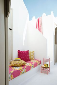 "Get inspired by this space in Essaouira and pair brightly coloured fabrics against a crisp white background. A children's chair (this one is £33.75, by Habasco, from [link url=""http://www.design55online.co.uk/""]Design 55[/link]) makes for a quirky tiny table.  [i]Taken from the September 2013 issue of House & Garden. Styling: Gabby Deeming. [/i]"