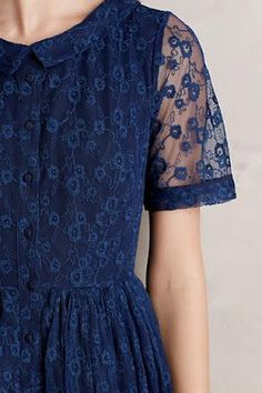 I like that the sleeve is sheer but the shoulder isn't. The little flower pattern is cute. This is a good shade of blue