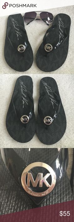 Michael Kors flip flops Black with silver hardware flip flops by Michael Kors New! without tags( sunglasses not included) These flip flops do not come in half sizes. They are marked size 8 but also fit a size 7 1/2. Michael Kors Shoes Sandals