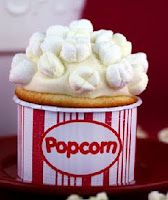 """Ok, I am a cupcake making fool, so I died when I saw these from MarthaStewart.com. Super easy to make the """"popcorn"""", just take mini-marshmallows and indent an """"X"""" shape across them, everyone will be wowed!Will have to pass this idea on to a baker friend!"""