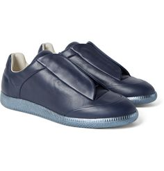 Lauded for its minimalist aesthetic, <a href='http://www.mrporter.com/mens/Designers/Maison_Margiela'>Maison Margiela</a> is an arbiter of street-style cool. These aptly named 'Future' sneakers are crafted from supple leather and set on metallic-blue rubber soles. Since they're free from other embellishment, they're actually surprisingly easy to wear.