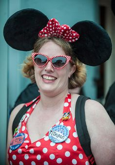 Megan Ross of Fresno who's birthday also happens to be the same as Disneyland's 60th birthday celebration Friday morning, waits along Main Street USA for the park to open. http://www.ocregister.com/articles/disney-672399-disneyland-park.html