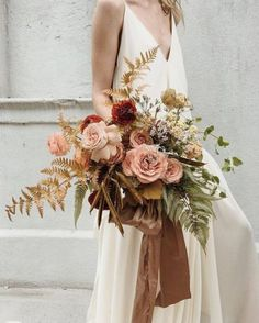 Wedding Flower Arrangements Can't take our eyes off this gorgeoous bouquet created by Absolutely loving the loosely yet elegant arrangement of autumnal… - Fall Bouquets, Fall Wedding Bouquets, Bride Bouquets, Floral Bouquets, Floral Wedding, Wedding Colors, Bouquet Flowers, Orchid Bridal Bouquets, Gold Bouquet