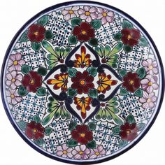 Hand painted talavera plates are used for dining and decorating kitchen walls. A red, white, green and cobalt plate from Mexico is microwave safe. by Rustica House #myRustica