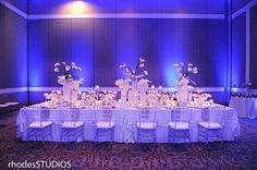 Magical centerpieces  table setup pop nicely with fab #uplight lighting! Great photo via #RhodesStudios