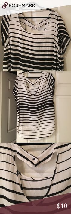 Torrid black and white top Torrid top! Never worn. Took tag off to wash and button came off. Still have to send with shirt. Runs small. Is a 3 but fits like a 2 due to pleating on bust. torrid Tops Blouses