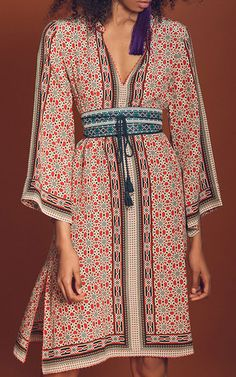 This **TRYB212** Primrose Bell Sleeve Dress features an allover print, banded collar, and relaxed fit.