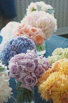 One type of flower in a colorful hue can make a big impact and won't distract from your dress (in terms of texture):