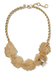 Add a golden touch to your look with our leaf motif statement necklace | Banana Republic