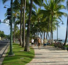 downtown Waikiki beach, to the right is the ocean and to the left is shopping on the main strip and straight ahead is Diamond Head