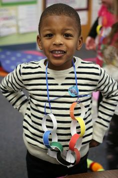 """A spin on the Thanksgiving Bracelet. Help build fine motor control while reinforcing concept vocabulary and teaching about Thanksgiving. Have students make connecting rings and model """"Through"""" (""""But the red """"through"""" the green"""") to build concept awareness. Fun!"""