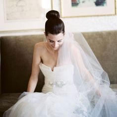 Wedding Hairstyle Idea: A Super Sleek High Bun Wedding Hairstyle