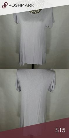 😲FINAL PRICE😲   SOFT LILAC HI LOW TOP This is a top made by LOGO, very good quality.  Not sure of the exact color,  to me it's a grayish lilac.   It's called a slub top.   Hi low hem.  Machine wash and dry.  Very Comfortable.  It is an xs but can also be worn by a small.  Great price for this brand! LOGO Tops Tunics
