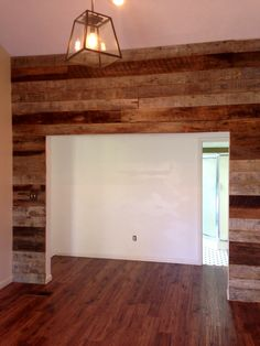 Accent wall done from recovered barn wood
