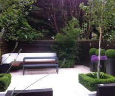 Photo Of Designer Modern Robert James Landscapes Garden And Decking Hardwood Landscaping Minimalist Town Patio Area Top