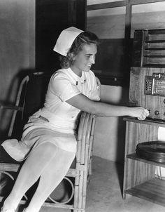 Nurse listening to a radio during World War II.
