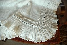 This elegant baby blanket is deceptively easy to knit.