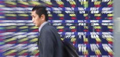 Asian Shares Tentative as Global Growth Concerns Linger