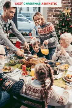 2021 cozy Christmas aesthetic for hygge Christmas. Yule ideas for pagans. A family enjoying a Christmas meal at the table with a Christmas tree and snowy day behind them. A large turkey and much food on the table.