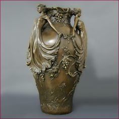 Art Nouveau A patinated bronze vase with three maidens