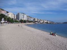 Resort hotels line the waterfront of the southern Albanian city of Saranda, blessed with a fine Ionian beach. It's a tradition for Albanian couples to spend their honeymoon here. Albania, Palermo, Hotels And Resorts, Coastal, Places To Visit, Blessed, Southern, Couples, City