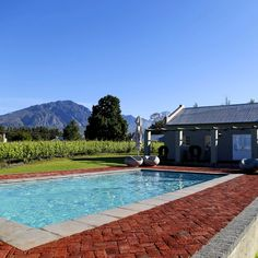 Enjoy the last few days of summer by the swimming pool at these lovely cottages.  Saronsberg Vineyard Cottages are at the foot of the Saronsberg mountains just outside Tulbagh and offers the tranquility you need to unwind.  #moutains #summer #swimmingpool #cottage #southafrica #west #relax