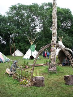 dad by the totem pole in the tipi field, via Flickr.