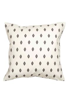 Cotton cushion cover: Cushion cover in a cotton weave with various print patterns front and back and a concealed zip at the bottom.