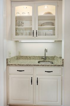Great idea how to tuck a wet bar into a small space or closet.  Charlottesville, Va.