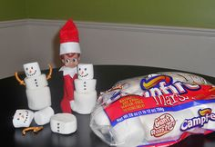Elf Makes Marshmallow Snowmen This elf decided to bring the winter inside and make some marshmallow snowmen friends! We love the touch of the pretzel arms!