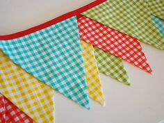 This is probably the Little House talking, but I picture a cute kids room decorated in gingham (like this bunting).