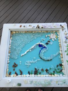 Working on a mosaic sea glass side table for my niece!
