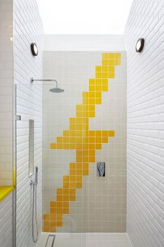 10 Inspirational Examples Of How To Include Yellow In Your Bathroom // You can always have a bit of fun, like this lightning bolt tile work done in yellow.