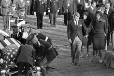 11/25/63: Burial of President John F. Kennedy at Arlington National Cemetery. His brother Robert F. Kennedy and widow Jacqueline Kennedy arrive with the president's mother, Rose Kennedy behind them as the coffin is placed at the grave. (AP Photo/John Rooney)