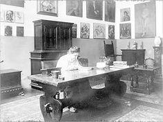 Gertrude Stein with billions worth of artwork on her walls.