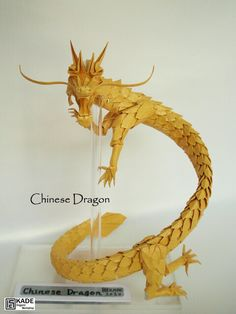 Chinese Dragon folded by kade chan 2010, photo via Flickr Paper Sizes Head : 15x15cm Body : 5x110cm (1:22) Feet : 8x16cm X 4 Time spent : 1 week Completed model : 50cm