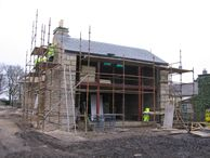 workers on unsafe scaffolding at a farm in the Ribble Valley