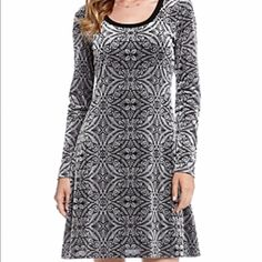 "Karen Kane Burnout Swing Dress Fully lined dress with patterned burnout fabric. Long sleeve. Scoop neck. Polyester/nylon/spandex. Approximately 34.5"" L. Dry clean. Made with love in the USA.  THIS DRESS IS CURRENTLY ON SALE AT BLOOMINGDALE'S FOR $103.50.  Karen Kane Dresses"