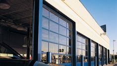 View our options for Aluminum full view doors. Great for modern commercial space with a variety of insulation and material options available. Commercial Garage Doors, Commercial Design, Multi Story Building, Architecture, Outdoor Decor, Modern, Arquitetura, Trendy Tree, Architecture Design