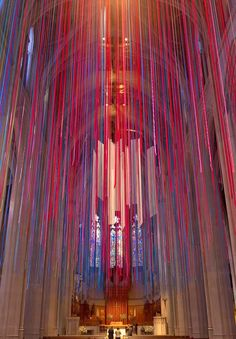To celebrate  100 Years of Music at the Grace Cathedral in San Francisco, An artist created Graced With Light, a music and stained glass-inspired installation that features nearly 20 miles of multicolored ribbons cascading from the church's vaulted ceiling arches.