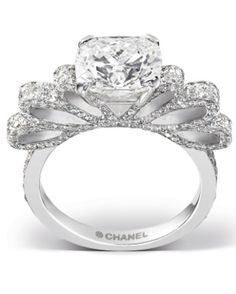 """Diamond Chanel bow wedding ring - 3.01 cushion cut diamond (surrounded by 246 brilliant cut sparklers) set on an 18k white gold """"ribbon"""" setting, it's Ruban 1932 ring, Chanel Fine Jewelry, $270,000; call 800-550-0005."""