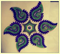 Following is the beautiful blue and light green combination of Kundan  Rangoli on OHP sheet. These Rangoli's are reasonable in price when order in  bulk.