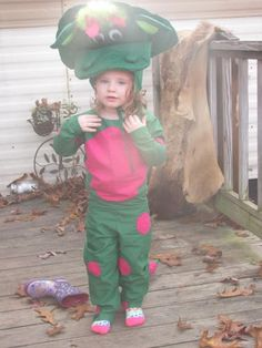 Baby-bop  Find a pair of  green pants and shirt. Take them and tear them apart at the seems. Then put them on news paper to make a pattern. Afterwards cut green material out making it a one piece outfit. Take a pink shirt and cut a oval out of it for the belly. Then cut small circles out of the same pink shirt and sewed them onto the body of the costume to make dots on the body. Stuff the tail. Check out your local Goodwill for all of your Halloween shopping : www.goodwillvalleys.com/shop